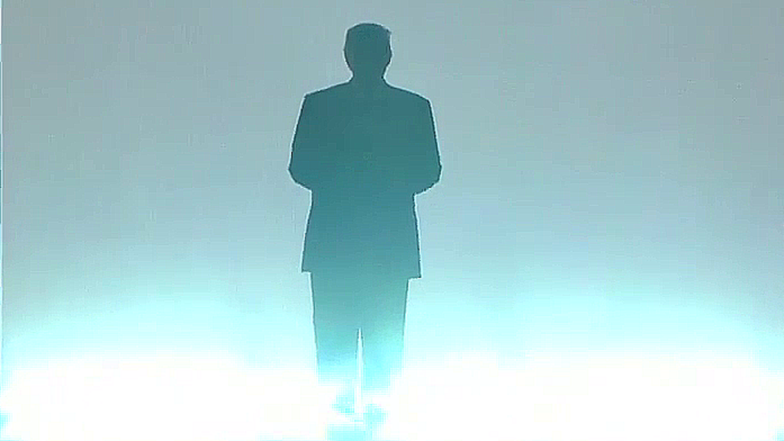Trump's shadowed silhouette appeared on stage, with bright white lights flanking him from below. (Photo Courtesy: RNC)