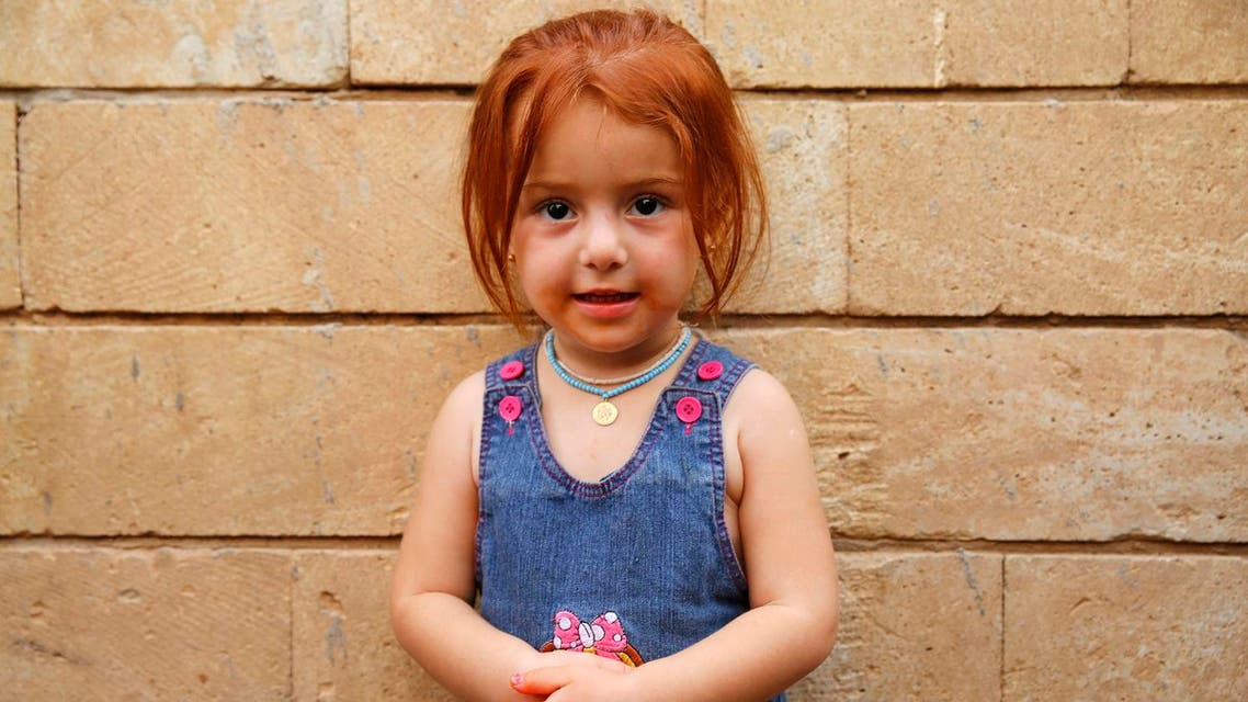 A displaced girl from the Yazidi minority, who fled violence from ISIS militants in the Iraqi town of Sinjar, poses for a portrait at the holy Lilash temple in northern Iraq September 20, 2014. (File photo: Reuters)