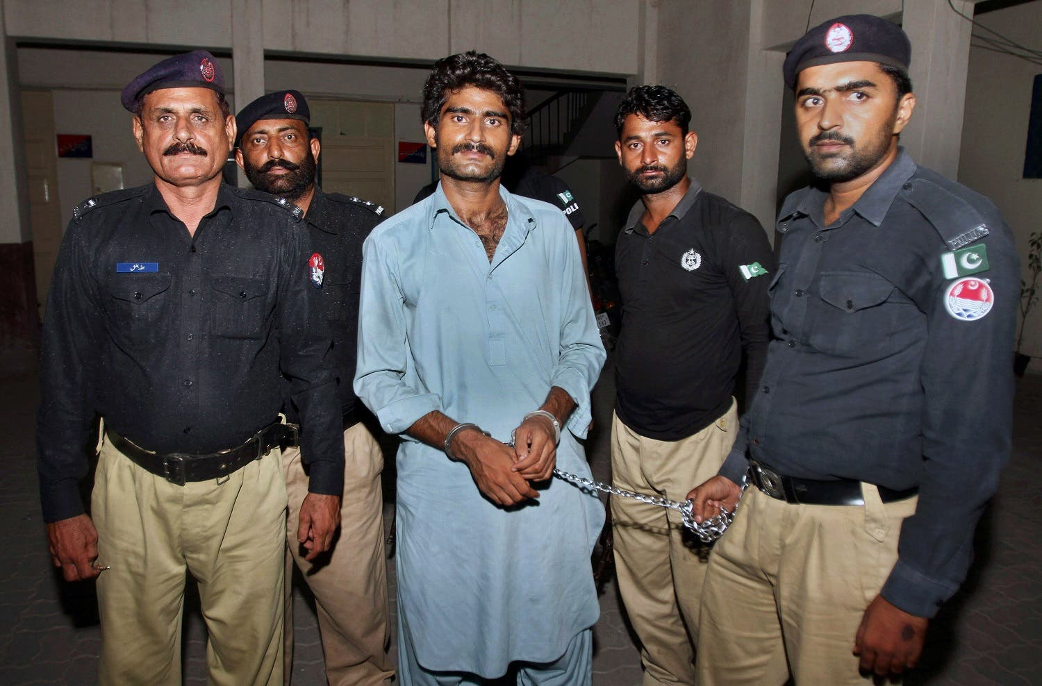 Pakistani police officers present Waseem Azeem, the brother of slain model Qandeel Baloch. (AP)
