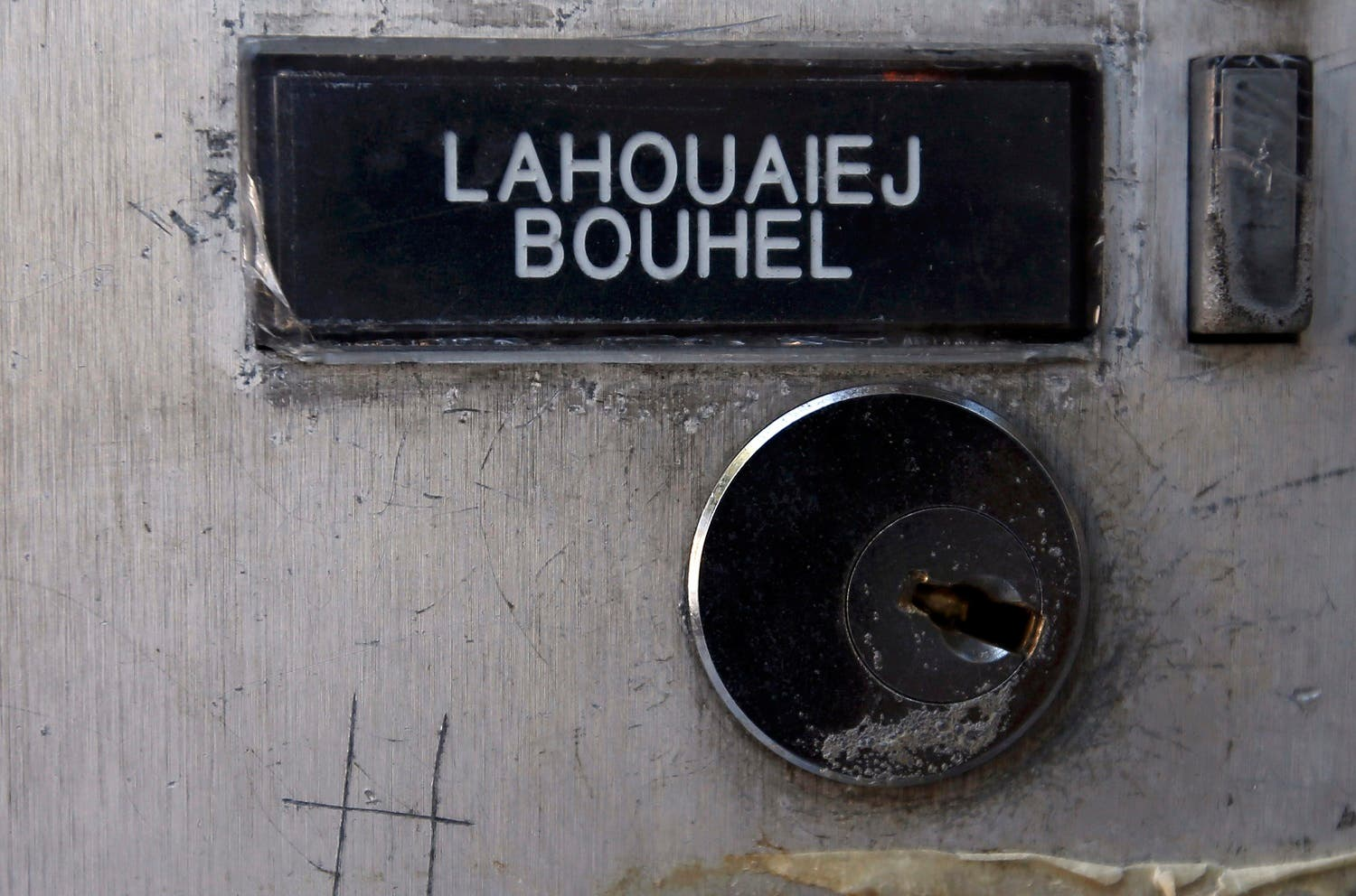 The name Mohamed Lahoualej Bouhlel is seen on a plate outside the building where he lived in Nice. (Reuters)