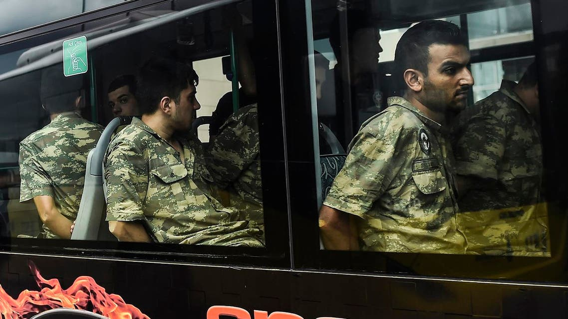 Detained Turkish soldiers who allegedly took part in a military coup arrive in a bus at the courthouse in Istanbul on July 20, 2016, following the military coup attempt of July 15. Turkish President Recep Tayyip Erdogan was today to chair a crunch security meeting in Ankara for the first time since the failed coup, with tens of thousands either detained or sacked from their jobs in a widening purge. BULENT KILIC / AFP