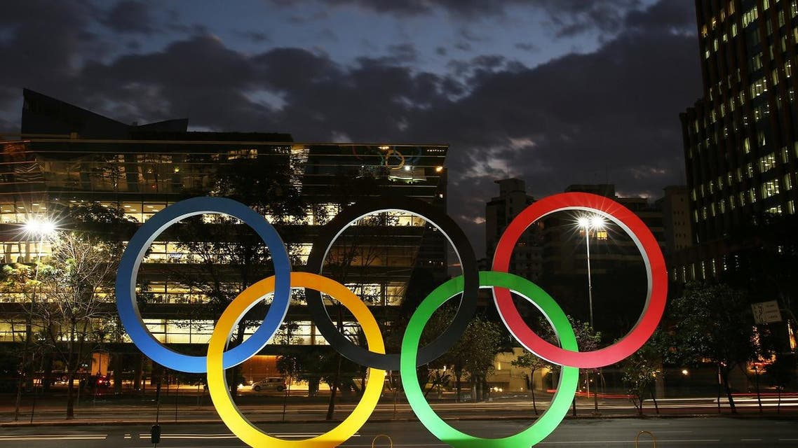 Olympic rings are seen at the entrance of office building ahead of the Rio 2016 Olympic Games, in Sao Paulo, Brazil, July 19, 2016. REUTERS