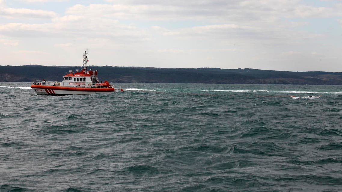A Turkish coastguard boat searches near the remains of a boat carrying suspected migrants from Afghanistan and Syria that sank just north of the Bosphorus Strait off the coast of Istanbul, Turkey, Monday, Nov. 3, 2014, leaving at least 24 people dead and several people missing. Seven people were rescued, Turkish authorities said.(AP Photo)