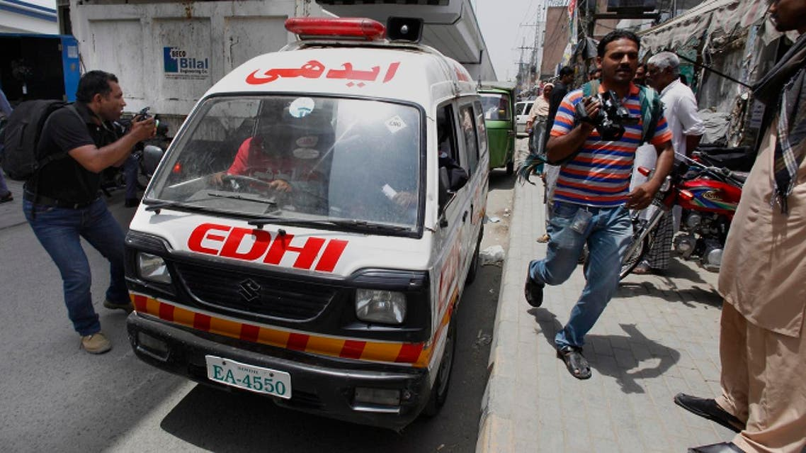 Members of media chase an ambulance transporting the body of Zeenat Rafiq, who was burned alive allegedly by her mother, to the morgue of a local hospital in Lahore, Pakistan, Wednesday, June 8, 2016. A Pakistani woman was arrested Wednesday after dousing her daughter with kerosene and burning her alive, allegedly because the girl had defied her family to marry a man she was in love with, police said. (AP Photo/K.M. Chaudary)