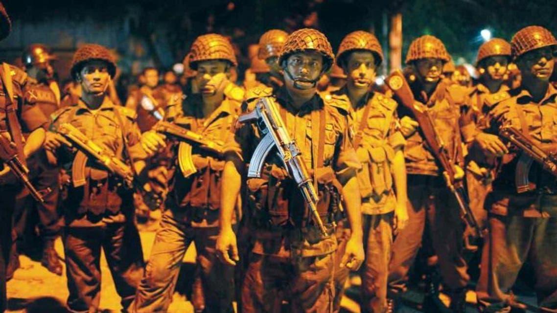 Bangladesh Border Guards are seen near Gulshan restaurant following a gunmen attack in Dhaka. (Reuters)