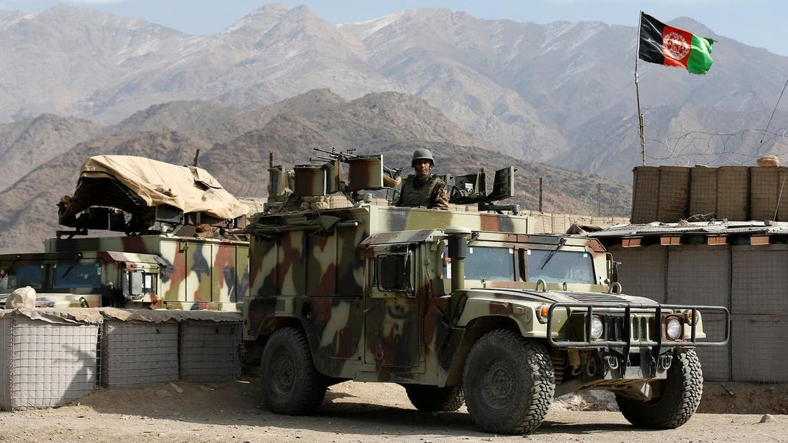 Afghan National Army (ANA) soldier keeps watch on the back of a Humvee at a check post in Logar. (Reuters)