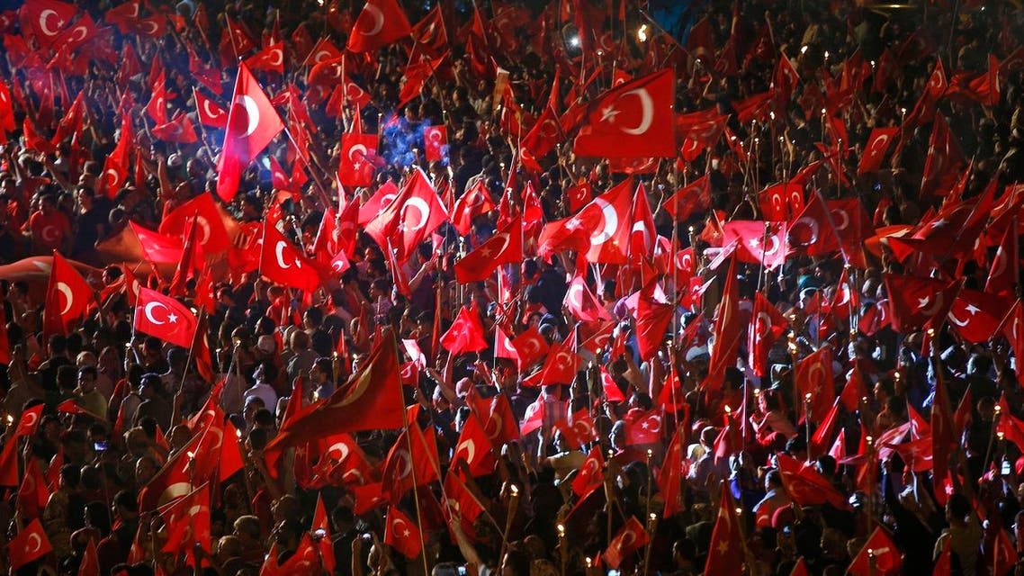 Pro-government supporters, waving Turkish flags participate in a rally on the road leading to Istanbul's iconic Bosporus Bridge, late Thursday, July 21, 2016. Turkish lawmakers approved a three-month state of emergency, endorsing new powers for Turkey's President Recep Tayyip Erdogan that would allow him to expand a crackdown that has already included mass arrests and the closure of hundreds of schools, in the wake of the July 15 failed coup. (AP Photo/Emrah Gurel)