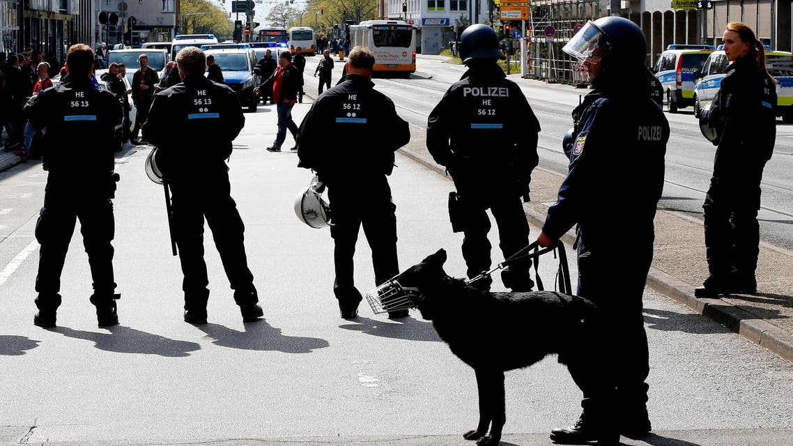German police officers guard a bar with Eintracht supporters in the city center in Darmstadt, Germany, Saturday, April 30, 2016. (AP)