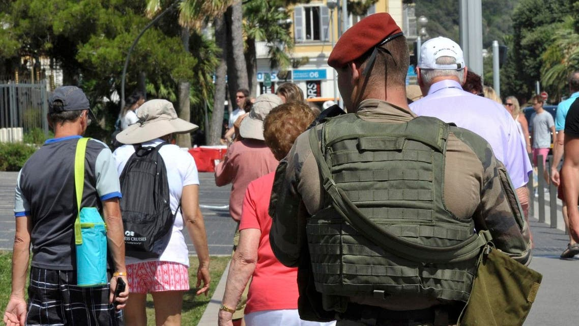 An armed French paratrooper patrols the street to maintain security after French lawmakers approved a six-month extension of emergency rule within France, in Nice July 21, 2016. REUTERS
