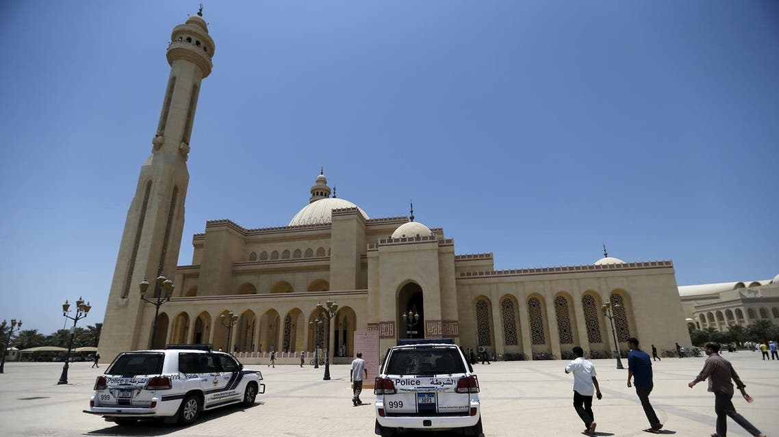 Police patrol vehicles are parked outside the main entrances of Bahrain Sunni Grand Mosque, where joint Sunni and Shi'ites Friday prayers were held to show solidarity and co-existence between the two sects of Islam, in Juffair east of Manama, Bahrain, July 10, 2015. In reaction to three bombings of Shi'ite mosques by the Islamic State militant group in Saudi Arabia and Kuwait since May 22, Sunnis and Shi'ites in Kuwait and Bahrain will pray together in main mosques as a sign of inter-sectarian unity. REUTERS