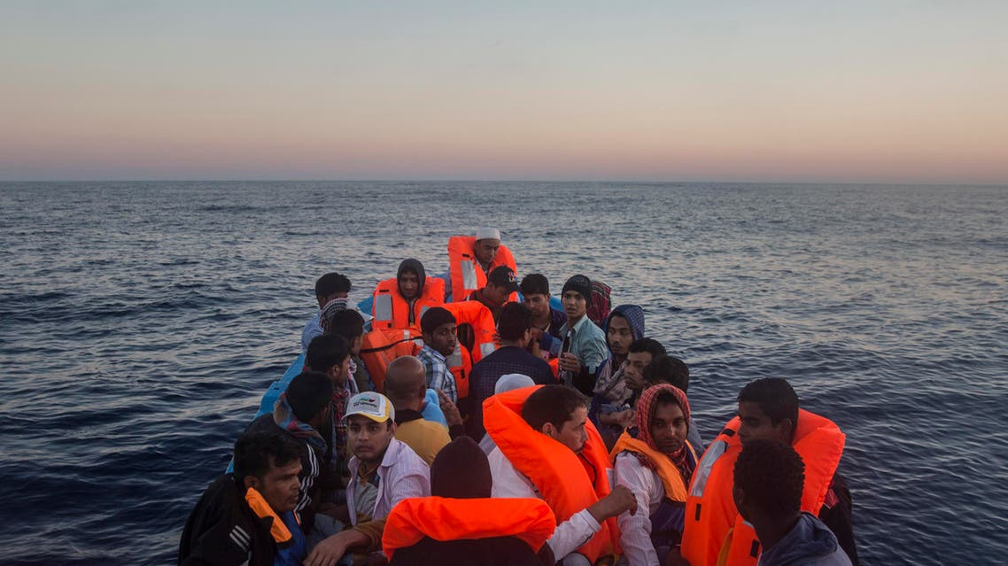 Refugees and migrants overcrowd a wooden boat during a rescue operation on the Mediterranean sea, about 19 miles north of Az Zawiyah, Libya, on Thursday, July 21, 2016. (AP)