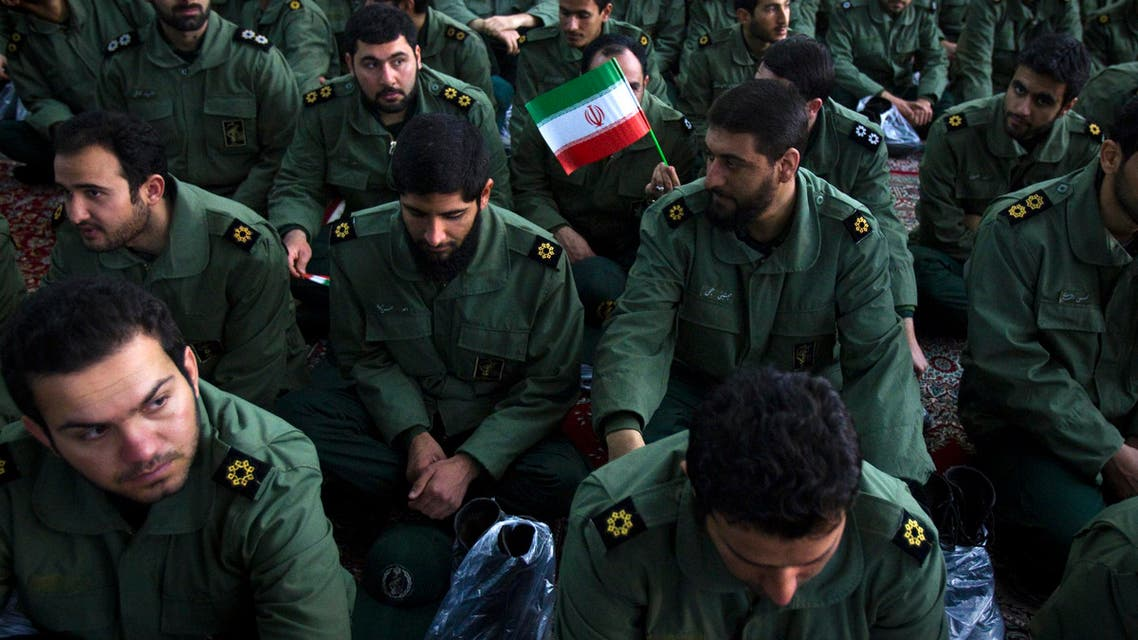 Members of the revolutionary guard attend the anniversary ceremony of Iran's Islamic Revolution at the Khomeini shrine in the Behesht Zahra cemetery, south of Tehran, February 1, 2012. (File photo: Reuters)