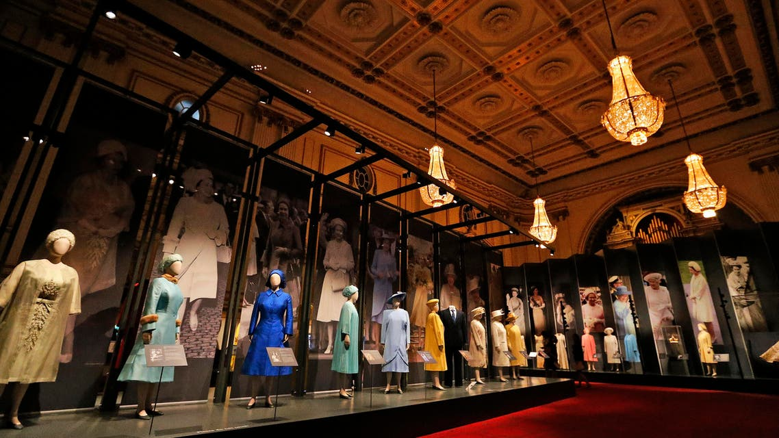 Dresses of Britain's Queen Elizabeth are on display at an exhibition at Buckingham Palace in London, Thursday, July 21, 2016. (AP)