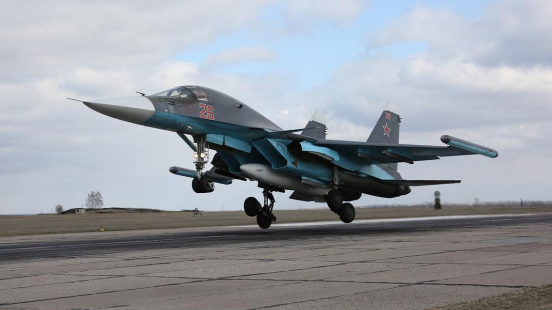 In this photo provided by the Russian Defense Ministry Press Service, Russian Su-34 bomber lands after returning from Syria at an airbase near the Russian city Voronezh, Tuesday, March 15, 2016.