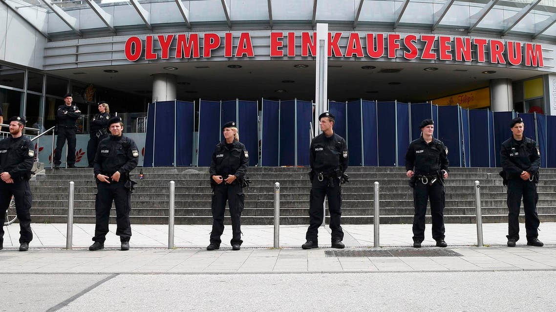 Police stand guard outside the Olympia shopping mall, where yesterday's shooting rampage started, in Munich, Germany July 23, 2016.  (Reuters)