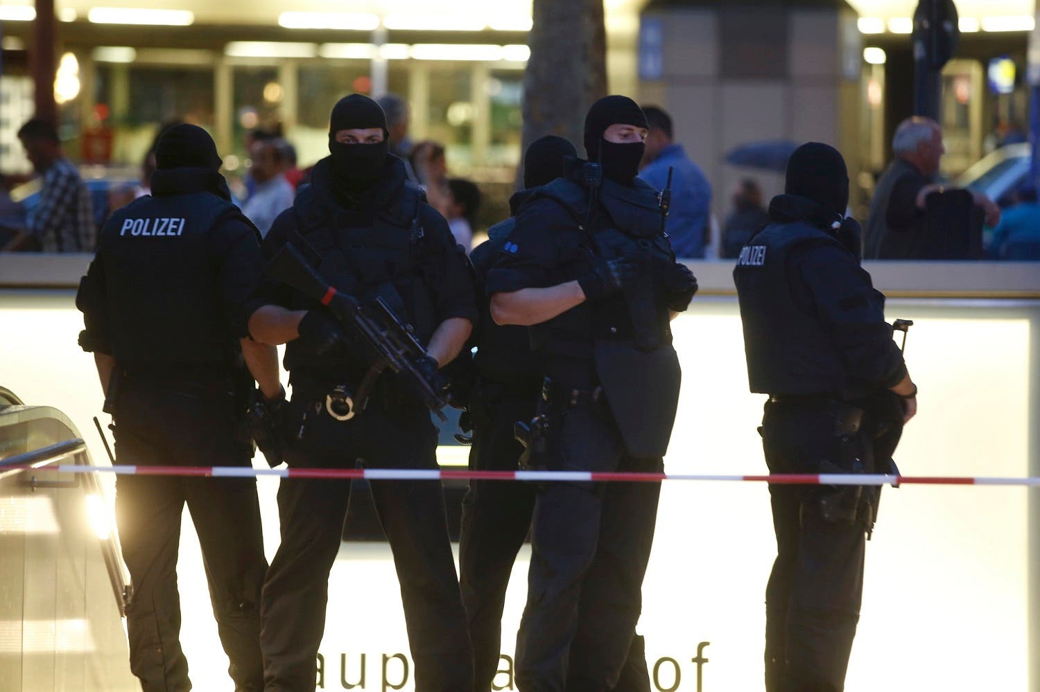 Special forces police officers stand guard at an entrance of the main train station, following a shooting rampage at the Olympia shopping mall in Munich, Germany July 22, 2016. REUTERS