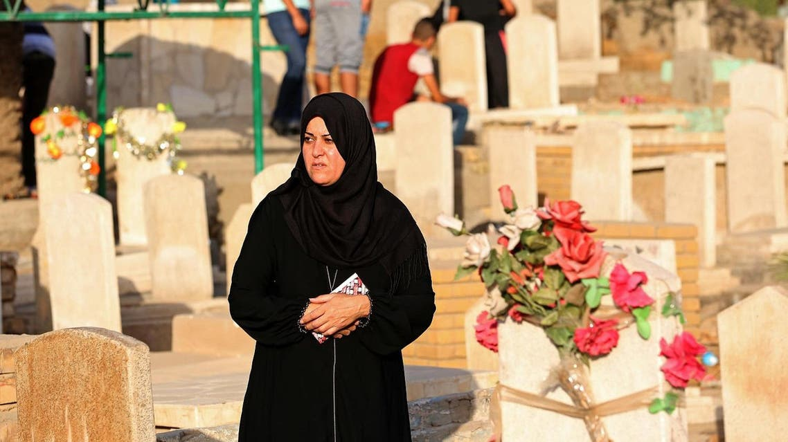Iraqis visit the graves of their relatives during the first day of the Muslim feast of Eid al-Fitr, that marks the end of the holy fasting month of Ramadan, and is traditionally celebrated with festivity, presents and new clothes, in Ghazali cemetery, Baghdad, Wednesday, July 6, 2016. AP