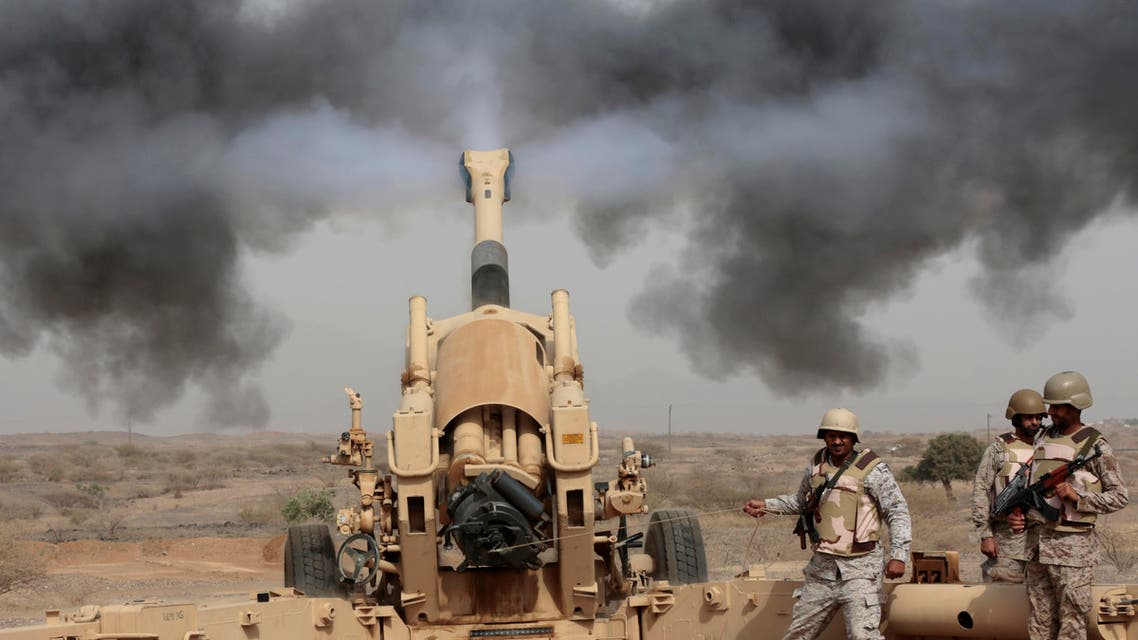 In this Monday, April 20, 2015, file photo, Saudi soldiers fire artillery toward three armed vehicles approaching the Saudi border with Yemen in Jazan, Saudi Arabia. AP