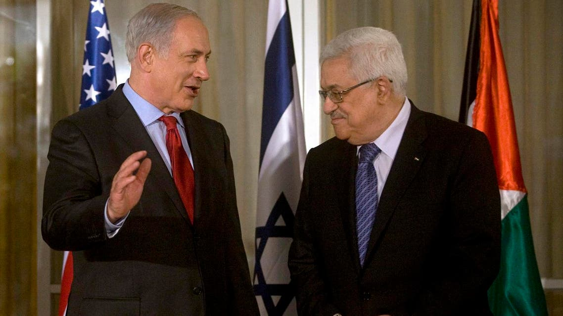 Israel's Prime Minister Benjamin Netanyahu (L) stands with Palestinian President Mahmoud Abbas before their meeting in Jerusalem September 15, 2010. Clinton warmly endorsed Israeli and Palestinian leaders on Wednesday ahead of negotiations to try to break a deadlock over Jewish settlement building in the occupied West Bank. REUTERS