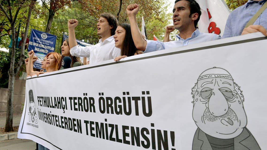 Pro-nationalist university students shout during a protest against U.S.-based cleric Fethullah Gulen and his followers during a demonstration in Ankara, on July 21, 2016.(AFP)
