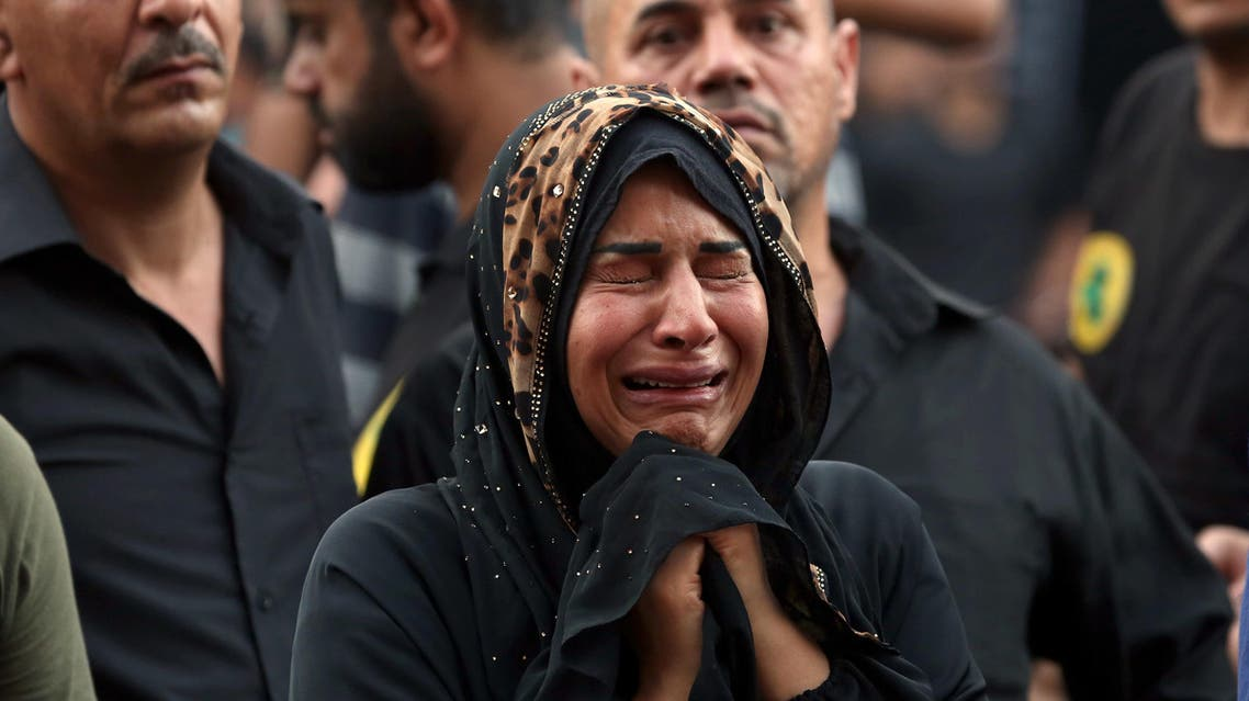 A woman grieves during the funeral procession of a bomb victim in the Karada neighborhood of Baghdad, Iraq, Tuesday, July 5, 2016. (AP)