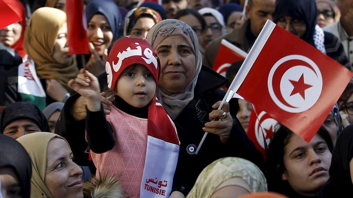 A girl waves a Tunisian flags during celebrations marking the fifth anniversary of Tunisia's 2011 revolution, in Habib Bourguiba Avenue in Tunis, Tunisia January 14, 2016. REUTERS