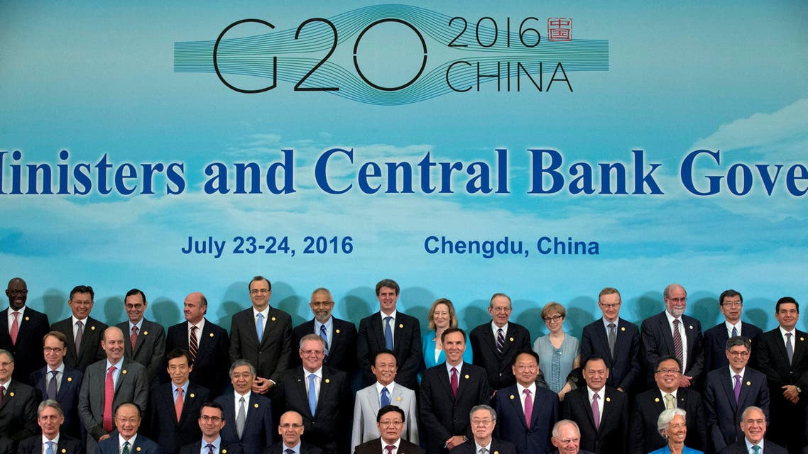 G20 Finance Ministers and Central Bank Governors (including from L in front row) Britain's Chancellor of the Exchequer Philip Hammond, World Bank President Jim Yong Kim, an unidentified member, Turkey Deputy Prime Minister Mehmet Simsek, China's Finance Minister Lou Jiwei, China's Governor of the People's Bank of China Zhou Xiaochuan, Germany's Federal Minister of Finance Wolfgang Schauble, International Monetary Fund managing director Christine Lagarde and Secretary-General of OECD Angel Gurria during a group photo in Chengdu in Southwestern China's Sichuan province, Sunday, July 24, 2016. REUTERS/Ng Han Guan/Pool TPX IMAGES OF THE DAY