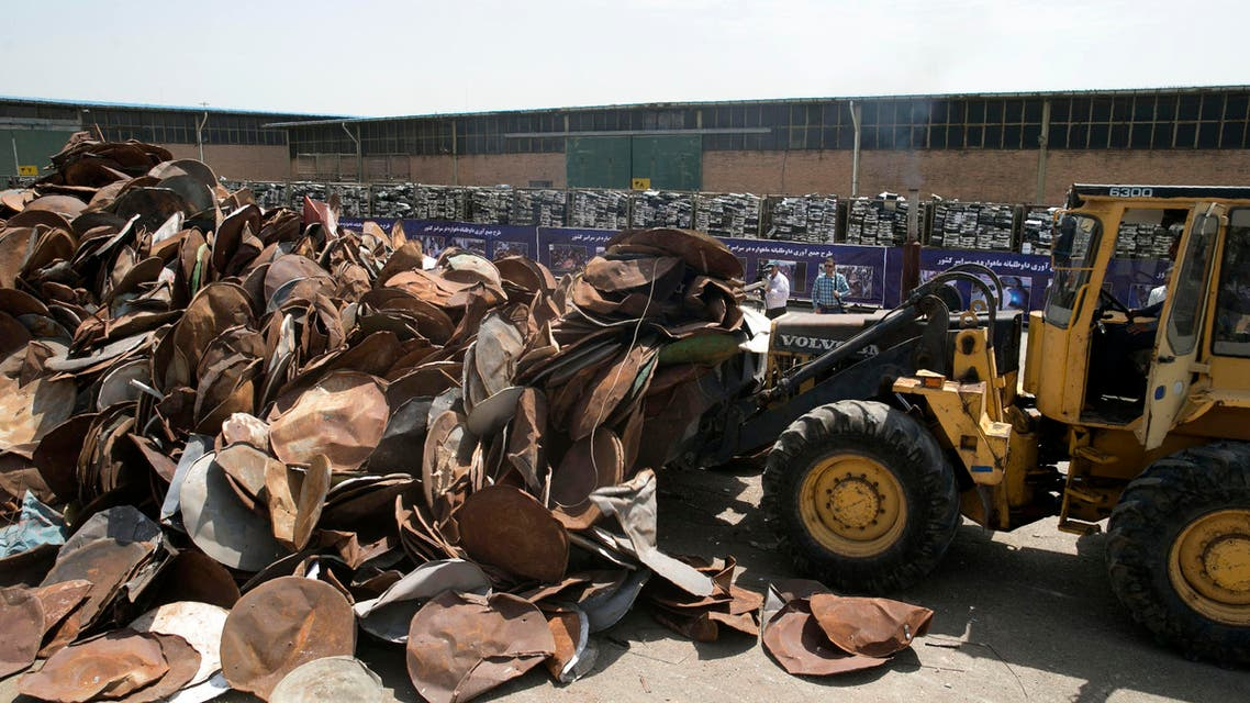A picture taken on July 24, 2016 shows satellite dishes and receivers being piled before being destroyed during a ceremony in the Iranian capital Tehran. Iran destroyed 100,000 satellite dishes and receivers as part of a widespread crackdown against the illegal devices that authorities say are morally damaging, a news website reported. The destruction ceremony took place in the presence of General Mohammad Reza Naghdi, head of Iran's Basij militia, who warned of the impact that satellite television was having in the conservative country. AFP