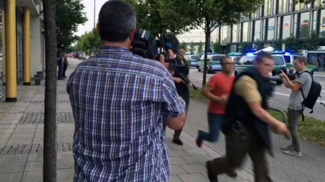 Armed police move past onlooking media responding to a shooting at a shopping center in Munich, Germany, Friday July 22, 2016. Munich police confirm shots have been fired at Olympia Einkaufszentrum shopping center but say they don't have any details about casualties. Police are responding in large numbers. (AP)