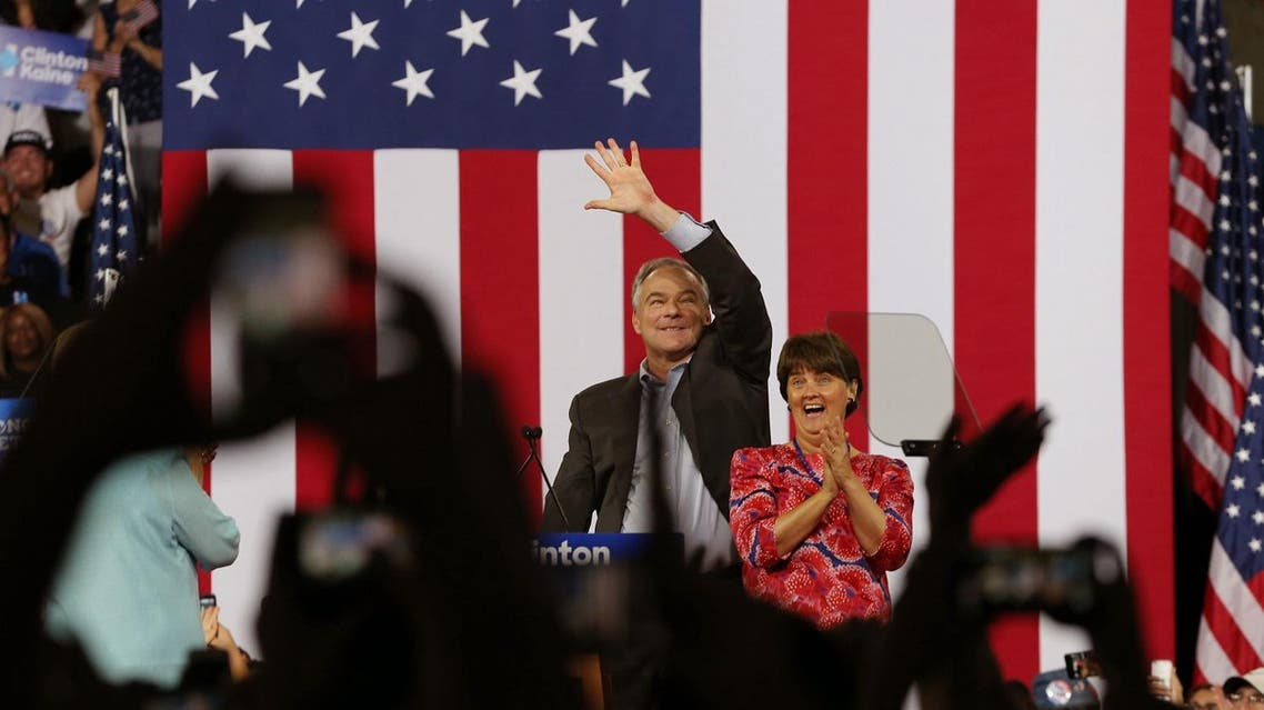 Democratic U.S vice presidential candidate Senator Tim Kaine (D-VA) waves with his wife Anne at his side after Democratic U.S. presidential candidate Hillary Clinton publicly introduced him as her vice presidential running-mate during a campaign rally in Miami, Florida, U.S. July 23, 2016. REUTERS/