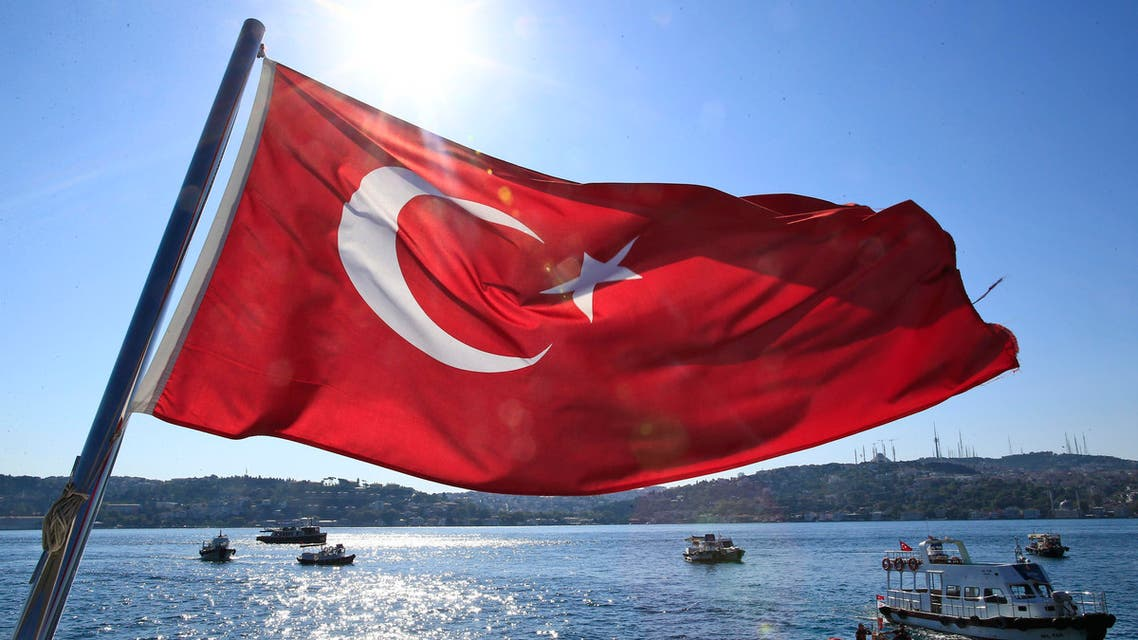 A Turkish flag flies near the Bosporus strait prior to the Bosporus Cross-Continental Swimming Race in Istanbul, Turkey, Sunday, July 24, 2016. (AP)