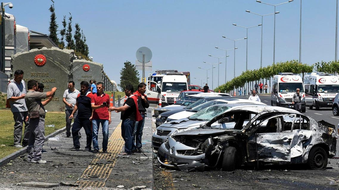 In this photo taken on Saturday July 16, 2016 and released Thursday, July 22, 2016, destroyed cars from overnight fighting during the attempted coup are seen outside the Presidential palace in Ankara. (Presidencial Press Service/Pool Photo via AP)