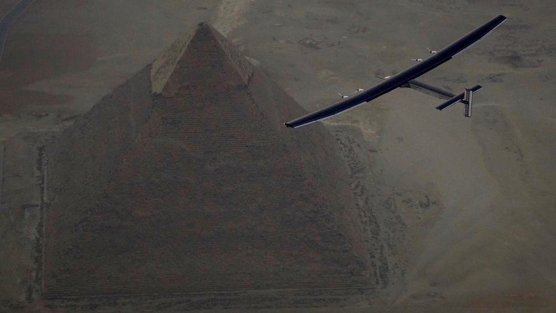 REFILE - QUALITY REPEATSolar Impulse 2, the solar powered plane, piloted by Swiss pioneer Andre Borschberg is seen during the flyover of the pyramids of Giza on July 13, 2016 prior to the landing in Cairo, Egypt in this photo released on July 13, 2016. Jean Revillard/SI2/Handout via Reuters ATTENTION EDITORS - THIS IMAGE WAS PROVIDED BY A THIRD PARTY. FOR EDITORIAL USE ONLY. NO RESALES. NO ARCHIVES.