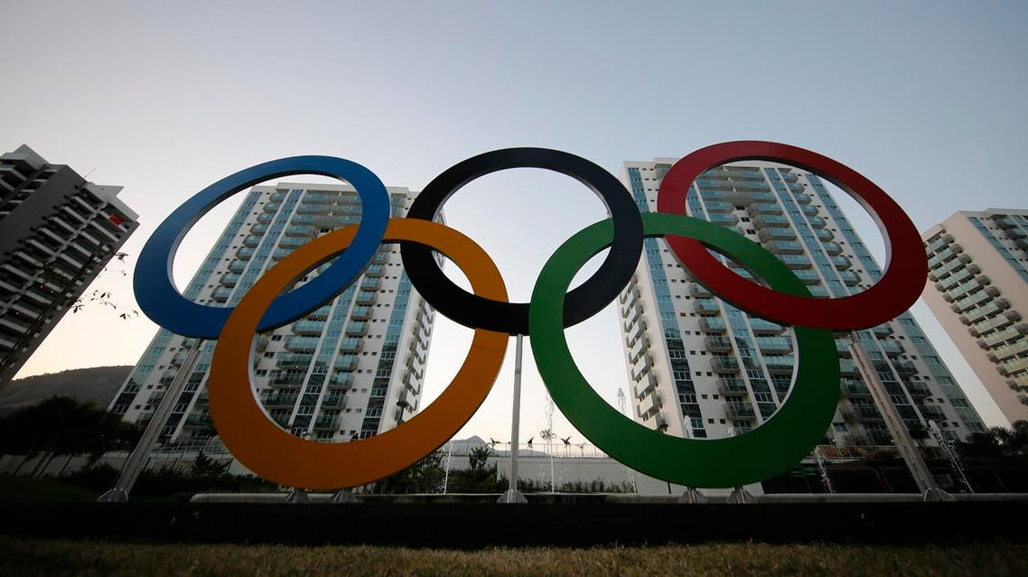 A representation of the Olympic rings are displayed in the Olympic Village in Rio de Janeiro, Brazil, Saturday, July 23, 2016. The brand new complex of residential towers are where nearly 11,000 athletes and some 6,000 coaches and other handlers will sleep, eat and train during the upcoming games, that will kickoff on Aug. 5. (AP Photo/Leo Correa)