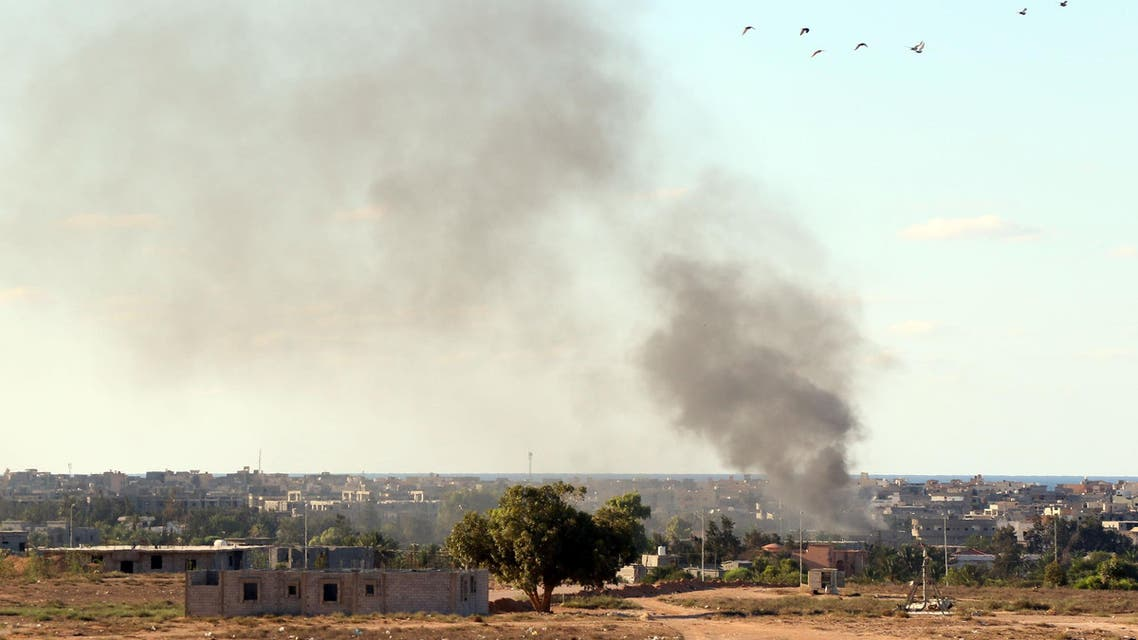 Smoke billows from buildings after the air force from the pro-government forces loyal to Libya's Government of National Unity (GNA) fired rockets targeting Islamic State (IS) group positions in Sirte on July 18, 2016, during an operation to recapture the jihadists' coastal stronghold. (AFP)