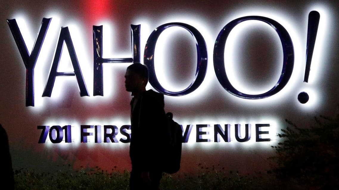 A person walks in front of a Yahoo sign at the company's headquarters in Sunnyvale, Calif. Verizon bought Yahoo in a sale announced Monday, July 25, 2016 (Photo: AP)