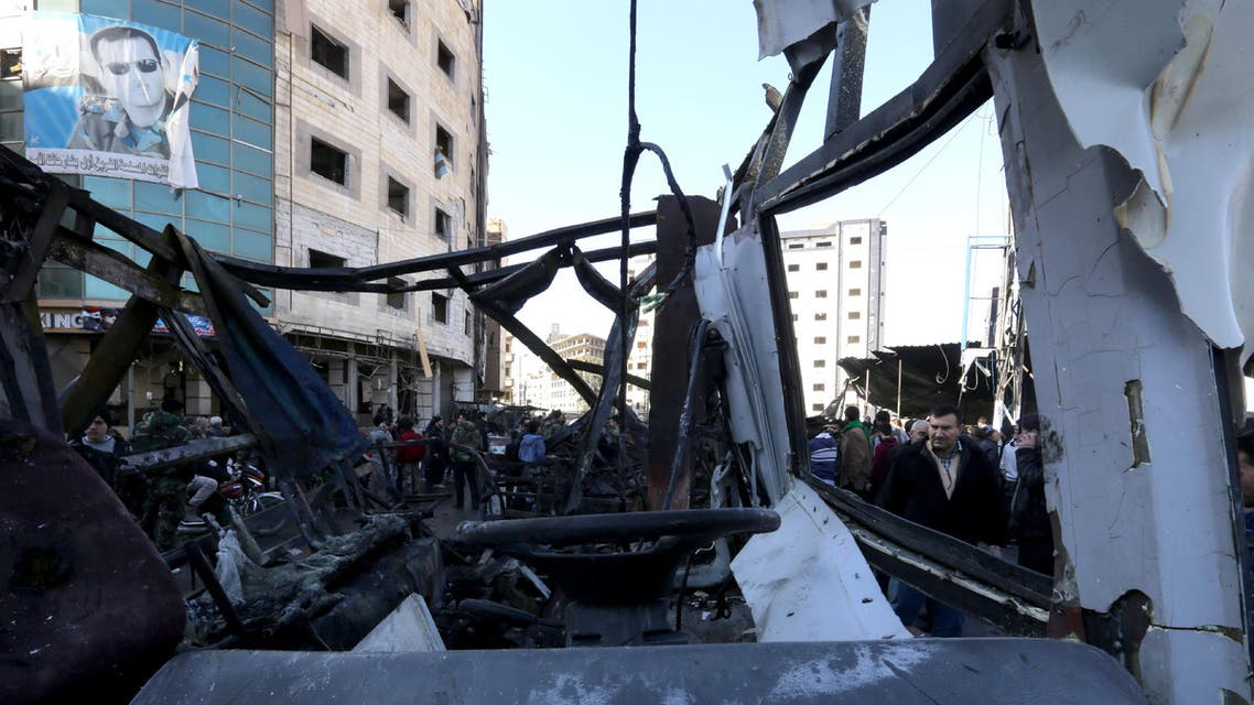 Syrian pro-government forces and residents gather at the site of suicide bombings in the area of a revered Shiite shrine in the town of Sayyida Zeinab, on the outskirts of the capital Damascus, on January 31, 2016. afp