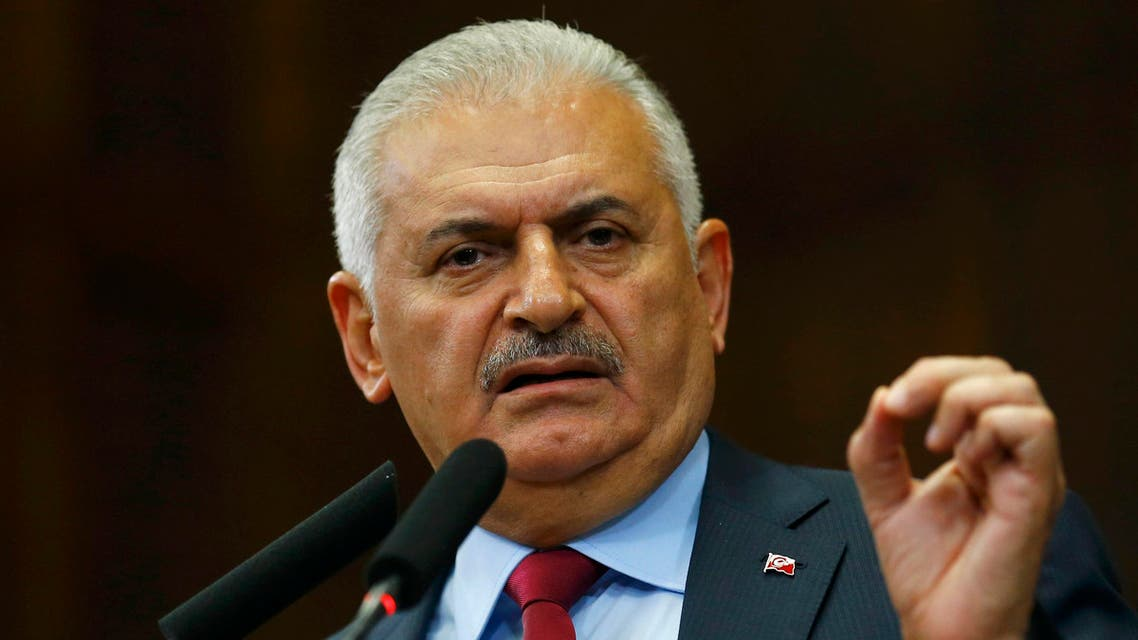 Turkey's Prime Minister Binali Yildrim addresses members of parliament from his ruling AK Party (AKP) during a meeting at the Turkish parliament in Ankara, Turkey July 19, 2016. REUTERS/Umit Bektas