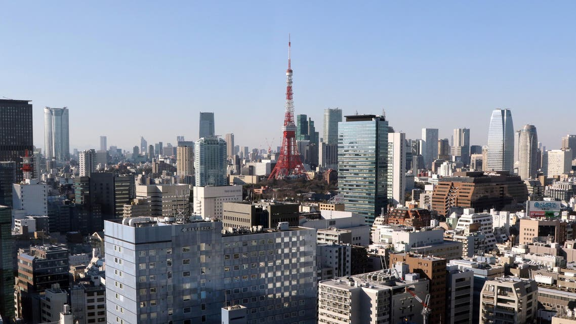 This picture taken on February 3, 2015 shows a general view of the Tokyo Tower (C) and the skyline of central Tokyo. (AFP)