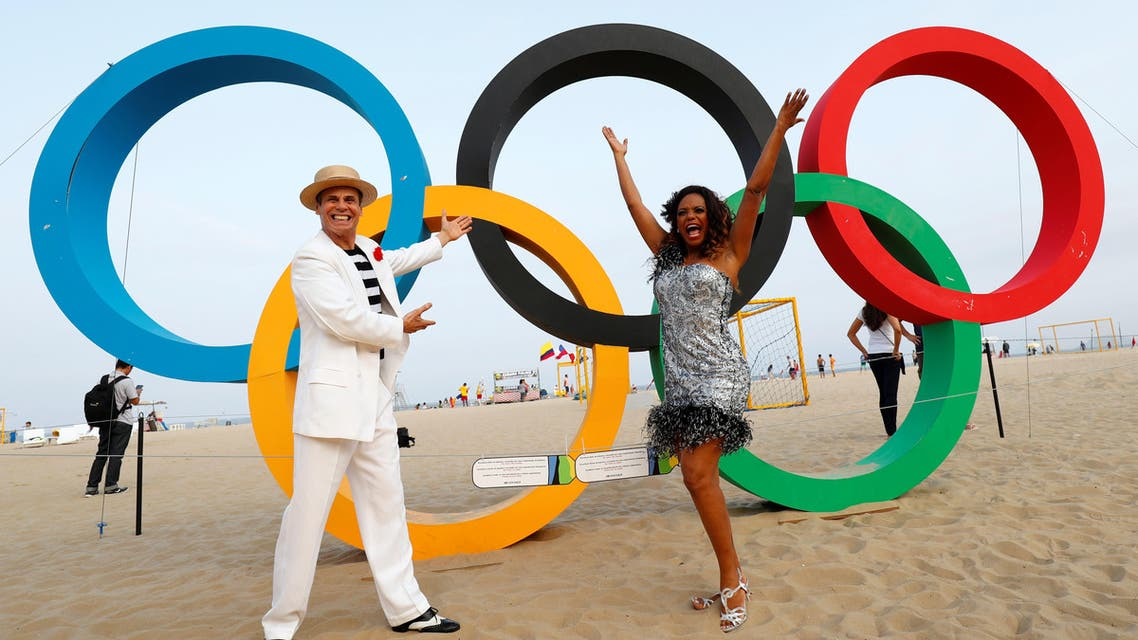 Street performers stand in front of Olympic rings on Copacabana Bean in Rio de Janeiro, less than two weeks before the start of the Rio 2016 Olympic Games, July 25, 2016. REUTERS