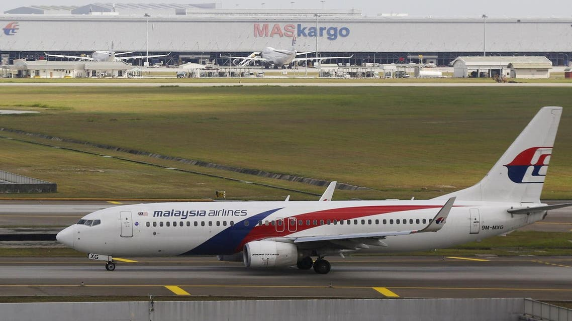 A Malaysia Airlines plane arrives at Kuala Lumpur International Airport in Sepang, Malaysia, March 2, 2016. REUTERS/Olivia Harris