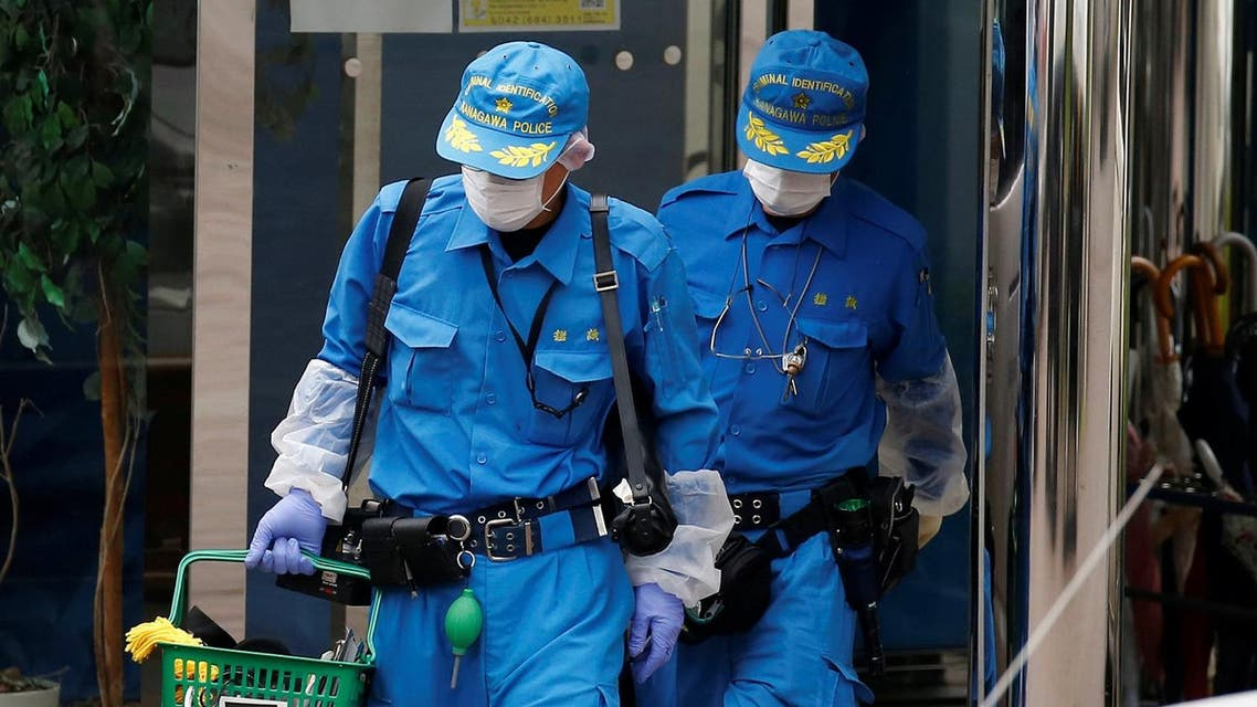 Police officers investigate at a facility for the disabled, where a deadly attack by a knife-wielding man took place. (Reuters)