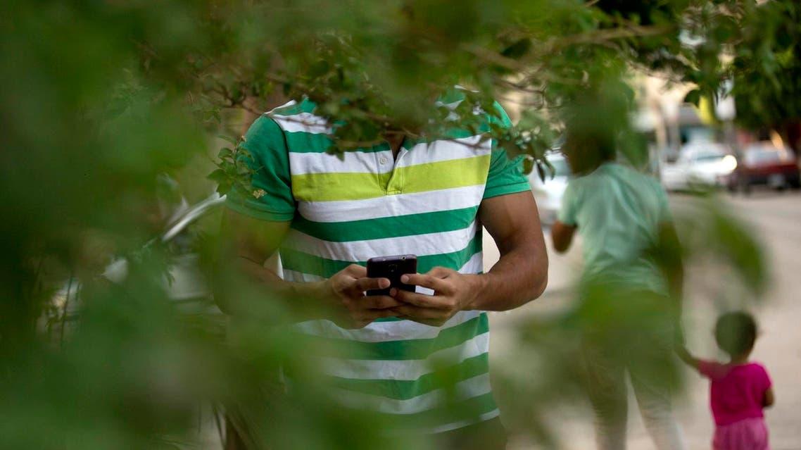A man plays Pokemon Go in a park  (Photo: AP)