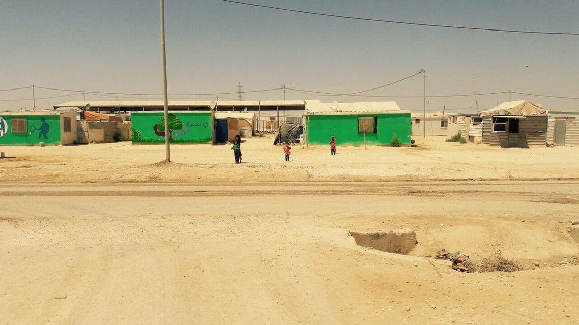 Children playing at Zaatari camp. Some of the camp inhabitants have painted their homes to add a little colour to the bleak surroundings. (UNICEF/MENA/Dakhlallah)
