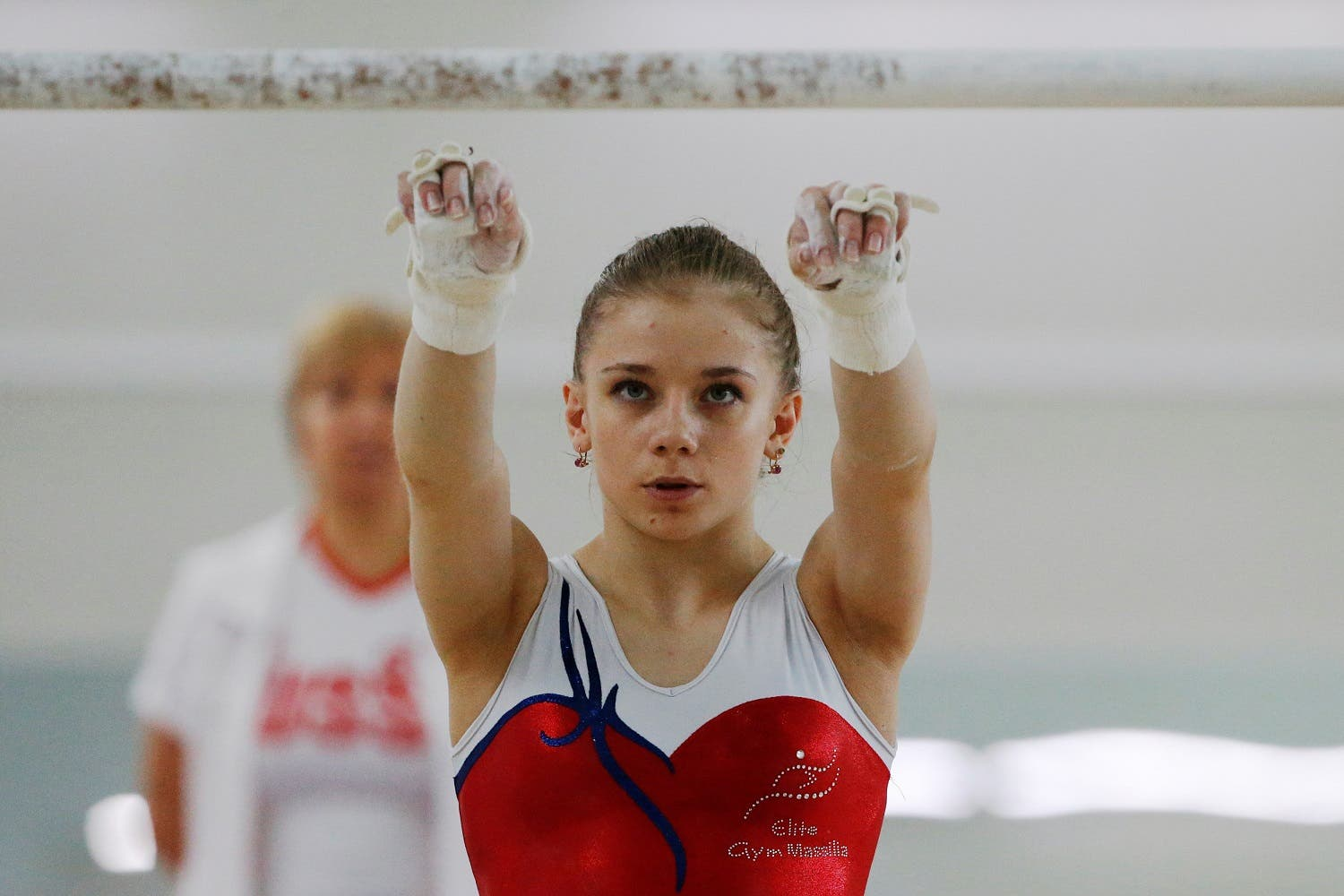 Member of the women's gymnastics Russian Olympic team Evgeniya Shelgunova attends a training session at the Ozero Krugloe (Round Lake) training centre outside Moscow, Russia, July 21, 2016. REUTERS