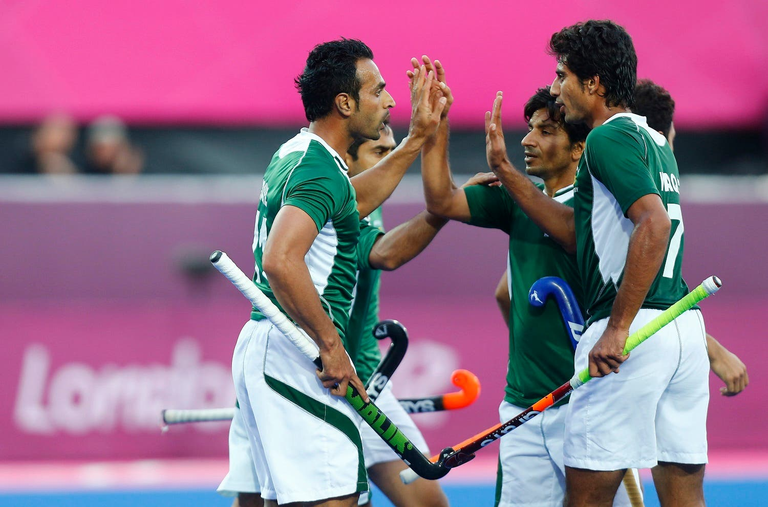 Pakistan's players celebrate their goal against Argentina during their men's Group A hockey match at the London 2012 Olympic Games at the Riverbank Arena on the Olympic Park August 1, 2012. REUTERS