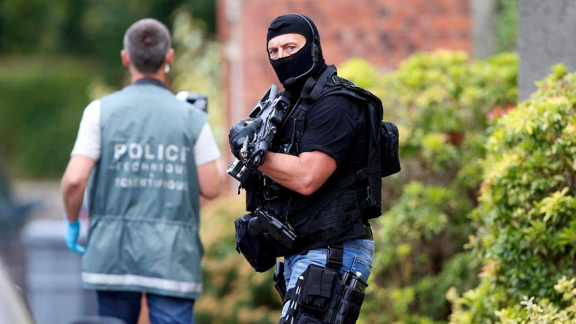 Members of French special police forces of Research and Intervention Brigade (BRI) and French scientific police are seen at the scene during a raid after a hostage-taking in the church in Saint-Etienne-du-Rouvray. (Reuters)