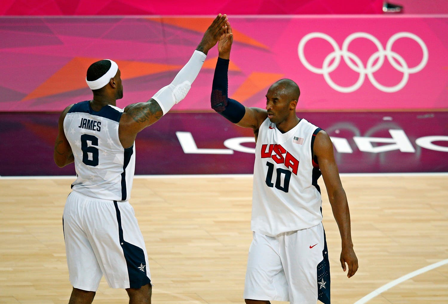 Lebron James (L) and Kobe Bryant both of the U.S. high-five each other during their game against Australia during their men's quarterfinal basketball match at the North Greenwich Arena in London during the London 2012 Olympic Games August 8, 2012. REUTERS/