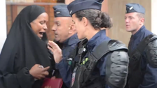 Muslim woman refugee clashes with French police after camp shutdown