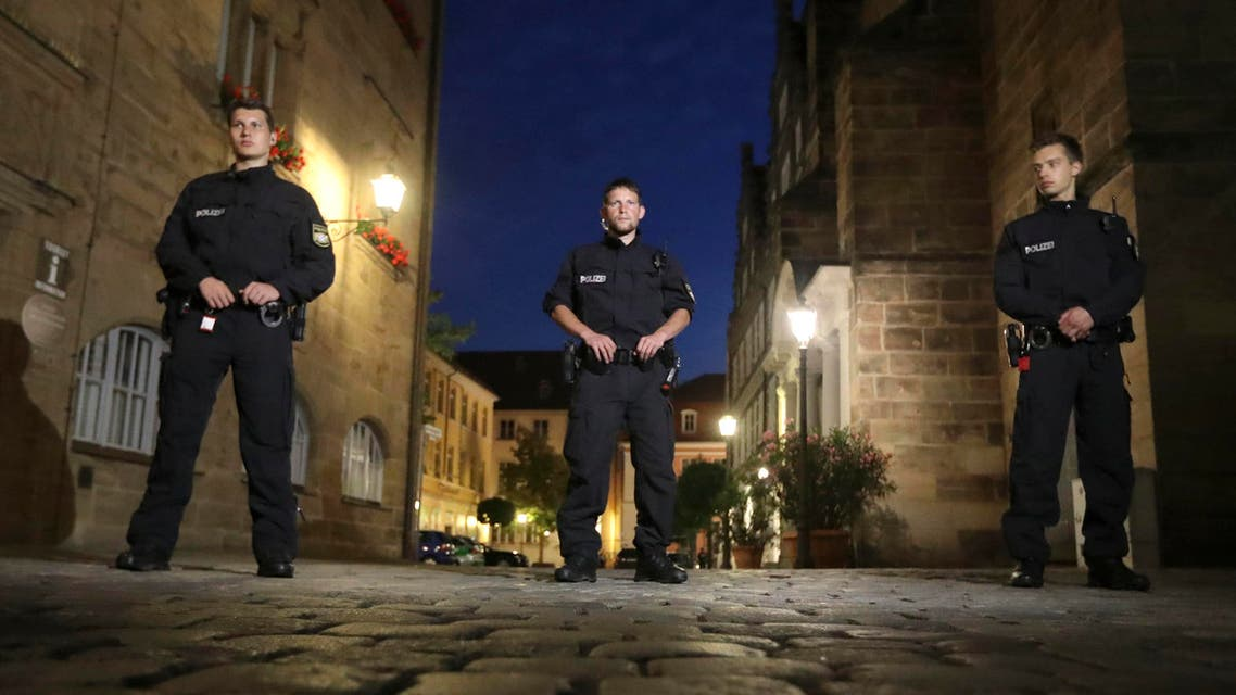 Police officers secure the area after a bomb attack in Ansbach, Germany, Monday, July 25, 2016. (AP)